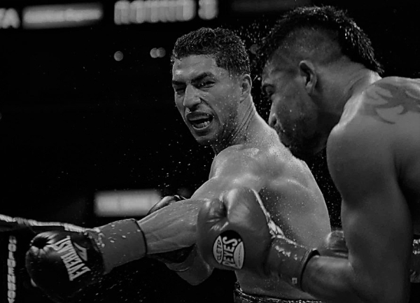 Lopez clips Ortiz with a left hook