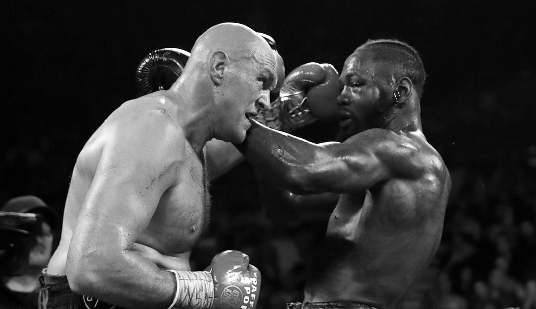 Tyson Fury and Deontay Wilder exchange blows